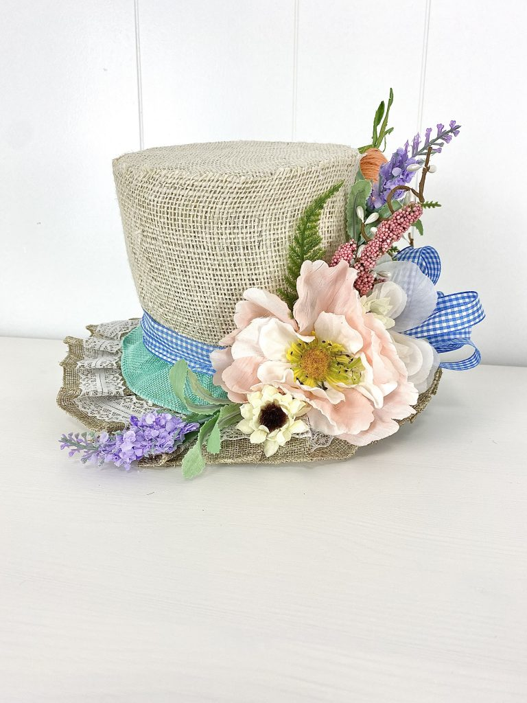DIY floral hat made from Dollar tree wire trash can, ribbon, and florals