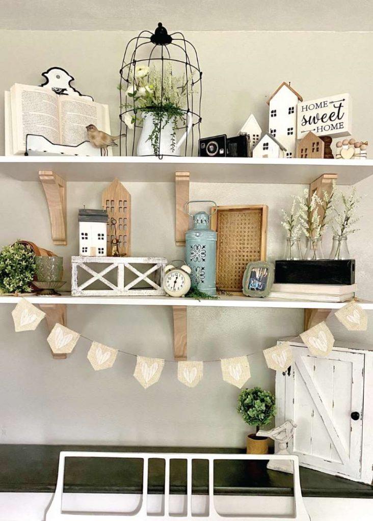 heidi sonboul decor shelf with heart burlap banner, and other decor items