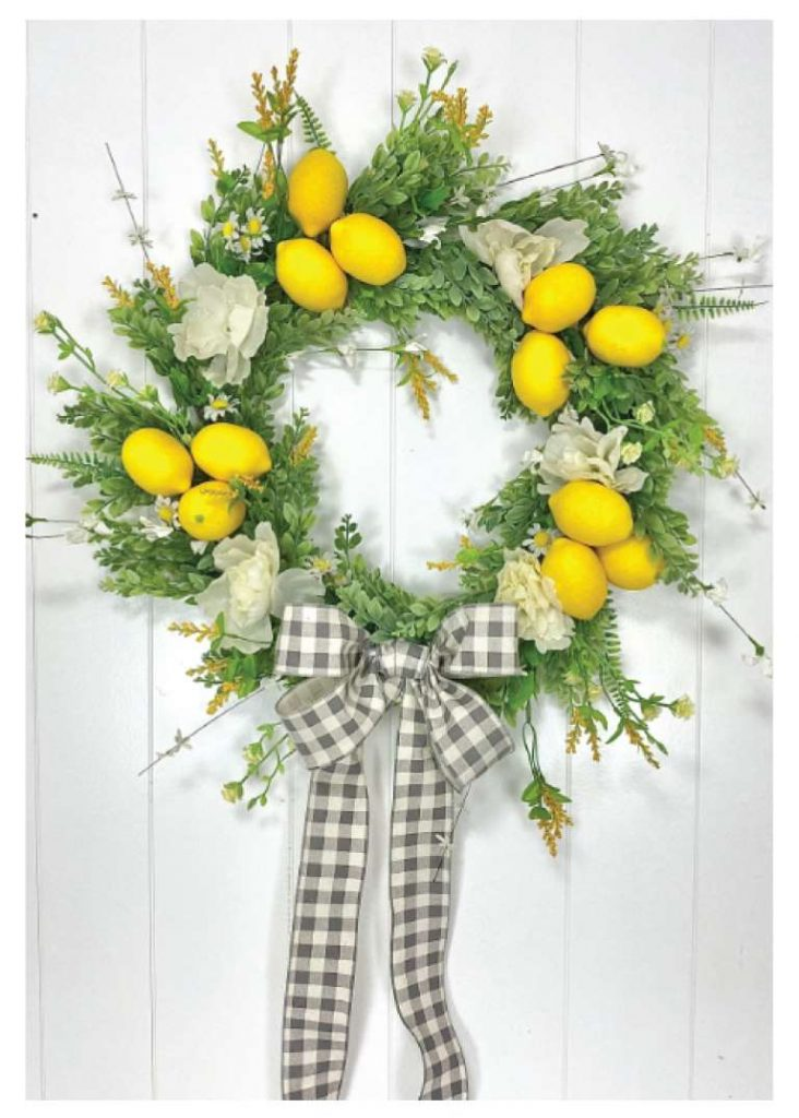 DIY Wreath with flowers lemons and a buffalo check grey and white bow
