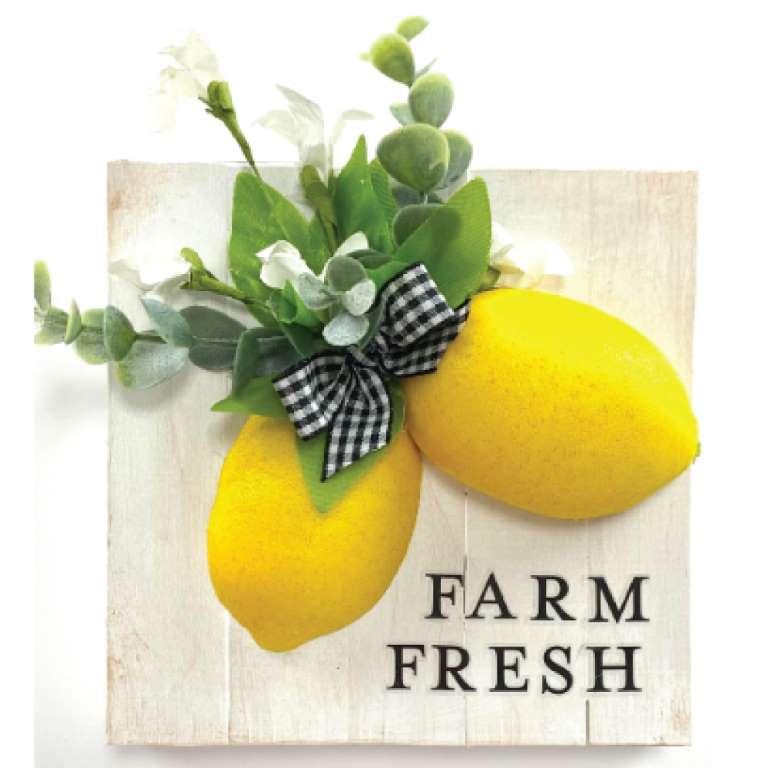 DIY farm fresh lemon sign with greenery and black white buffalo check bow