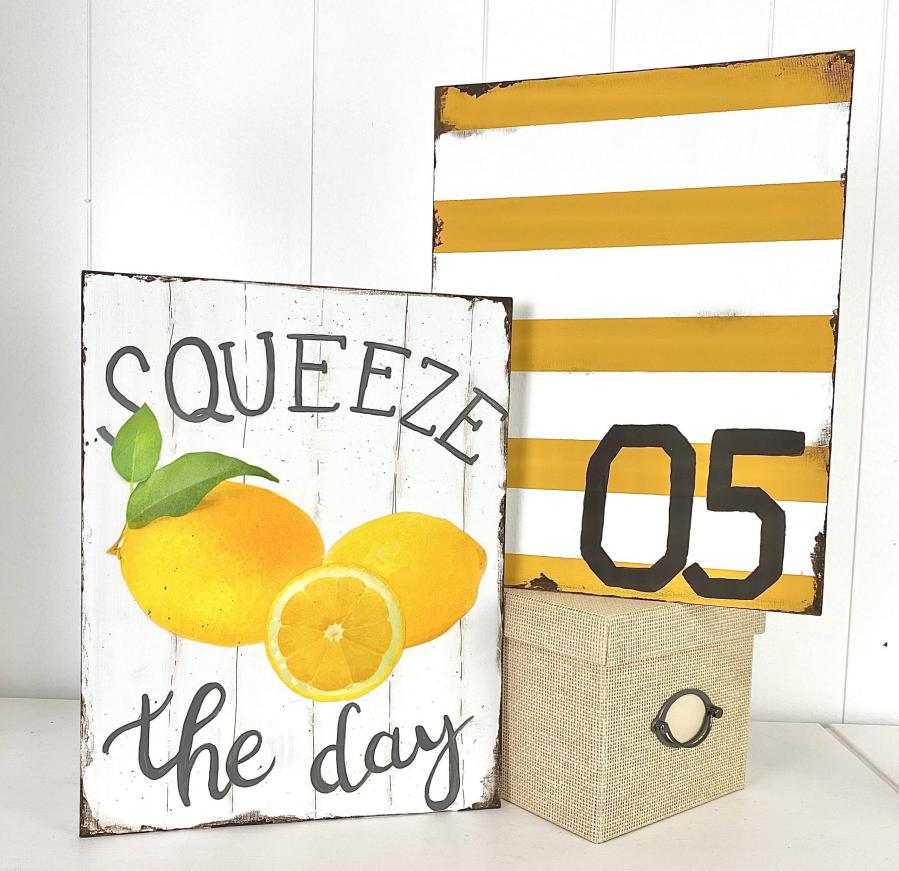 squeeze the day and yellow striped signs