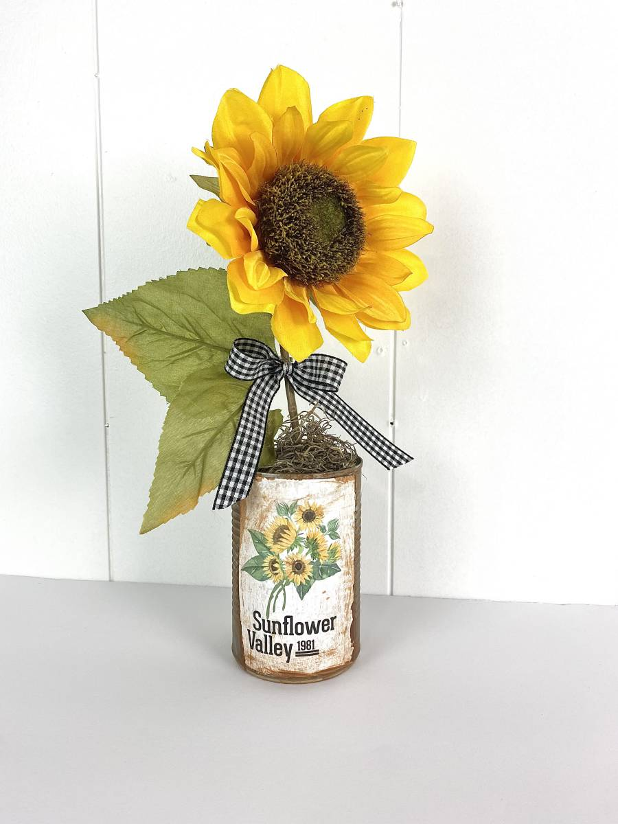 sunflower in a distressed tin can with a sunflower valley label