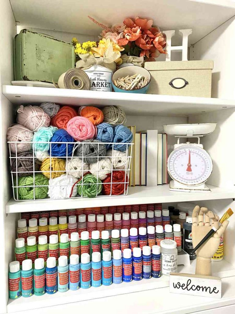 heidi sonboul craft room yarn and organized paints by color
